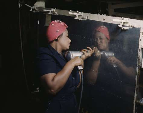"A real-life ""Rosie the Riveter"" operating a hand drill at Vultee-Nashville, Feb. 1943."
