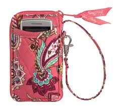 Love my Vera Bradley wristlet.  I can keep it in my purse or if I want to travel light, I just grab the wristlet.  Carries everything I need!