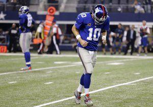New York Giants quarterback Eli Manning (10) leaves …