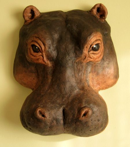 hippopotamus essays Hippopotamus is a thick-skinned animal with a huge rotund body on stubby legs and an enormously wide snout smooth, purple-brown skin is pink in creases and under-parts.