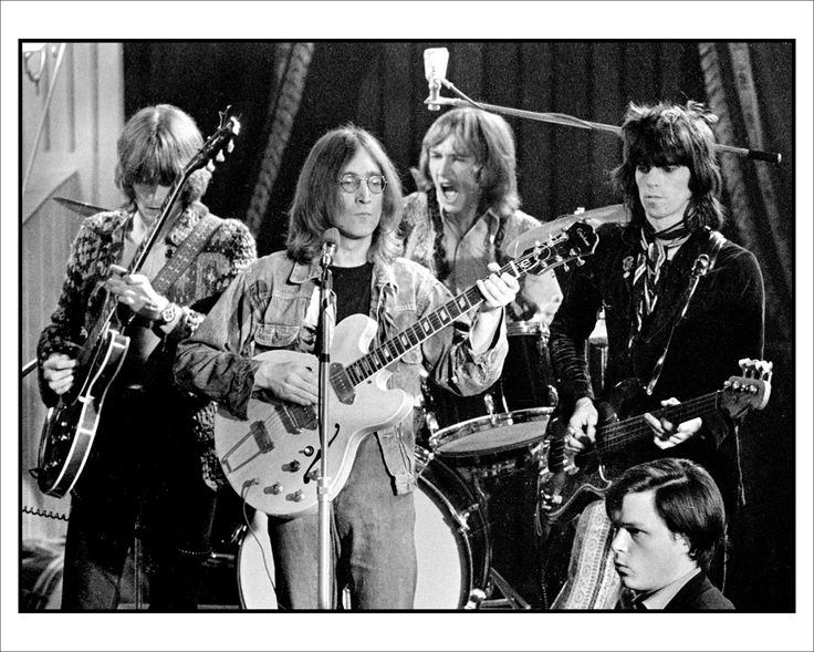 Eric Clapton,John Lennon,Mitch Mitchell,Keith Richards.  EPIC PHOTO