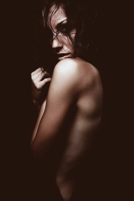 This is an example of the Chiaroscuro lighting technique. The model looks like she is emerging from the negative space. http://youtu.be/7uwR14oG7qA