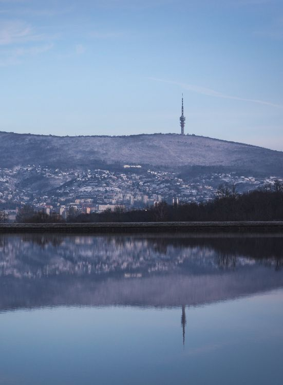Pécs, Hungary in the mirror of lake Malomvölgy on a winter morning in 2014. Pécs has interesting cultural life, but the surrounding landscapes are at least as beautiful as the city itself is.