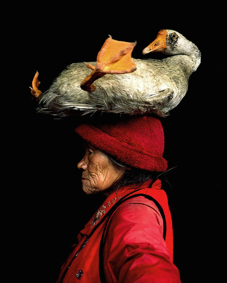 Lady with the goose, China.   By Cristina Mittermeier