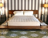 Reclaimed Wood Beam Bed - Handmade with reclaimed Pine from NYC. $2,195.00, via Etsy.