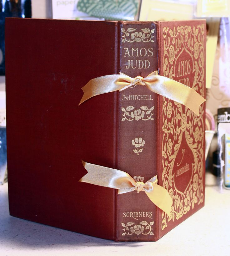 """simple altered book - cut out all the pages, create pages from scrapbook paper and attach your new """"book"""" to the old cover.  Perhaps use this idea to make custom """"smash books"""" for my nieces for Christmas?"""