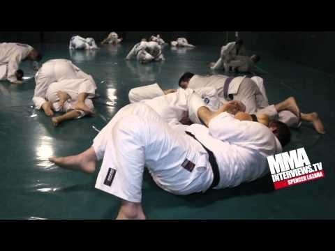 Ryron Gracie rolls with black belt Scott Morton at the Gracie Academy wi...