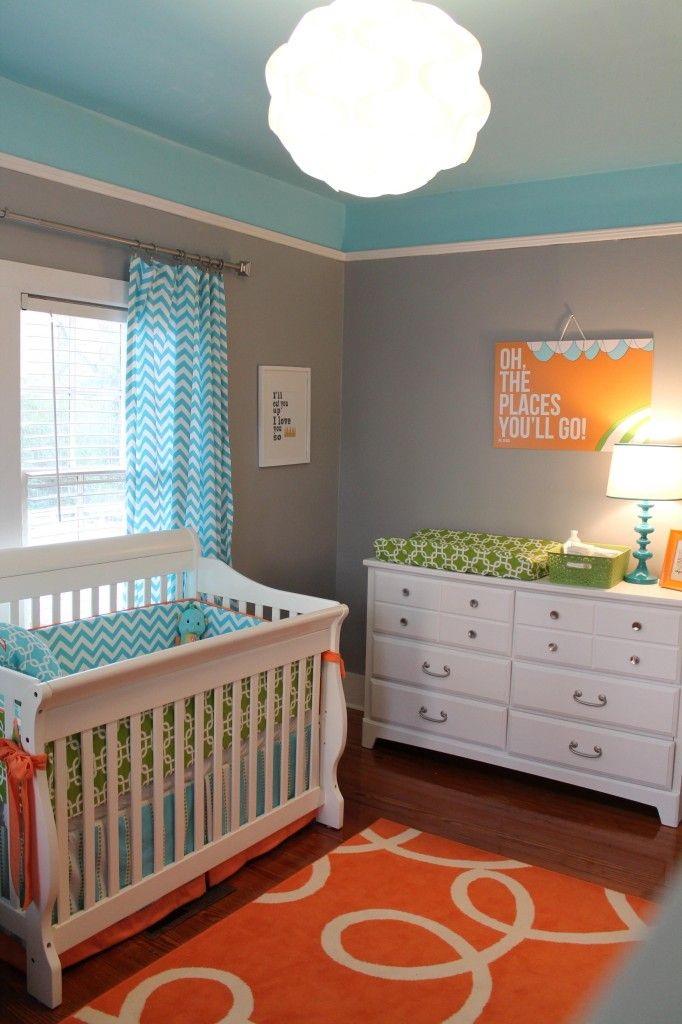 Gray, turquoise and orange is a winning color combo in this modern nursery!