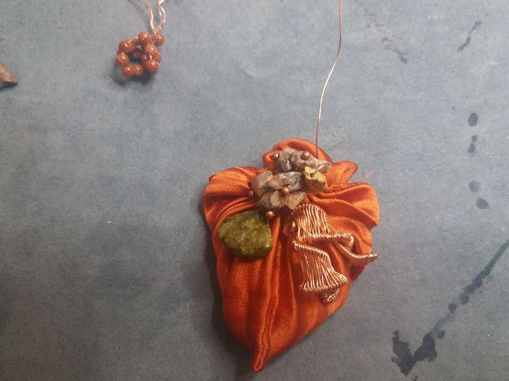 Cod-355 Golden brown shibori silk body decorated with copper ornaments and semi-precious stones.  https://www.facebook.com/Crown-Art-Jewelry-685629774912291