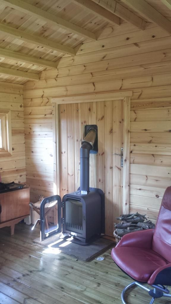 vesta-fire-exit-custom-wood-stove-03 Outdoor-Indoor install on a specially made safety hinged door. It swings out into the garden to warm the as-yet built deck-patio structure.