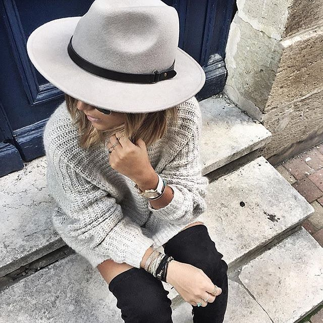 Wide-brimmed hat + oversized sweater + thigh-high boots = Fall outfit perfection