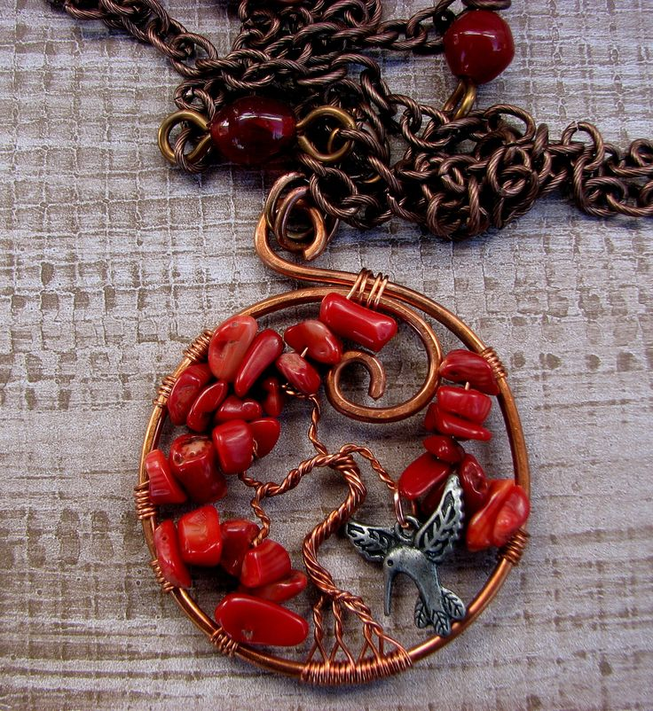 red bamboo coral tree of life with hummingbird accent. has been charged under the light of the last lunar eclipse.