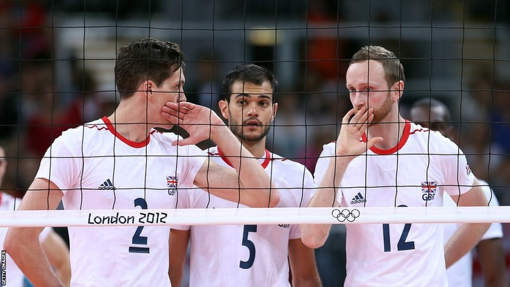 Ben Pipes, Mark Plotyczer & Christopher Lamont of Great Britain talk strategy in their first-ever Olympic volleyball match against Bulgaria at Earls Court.