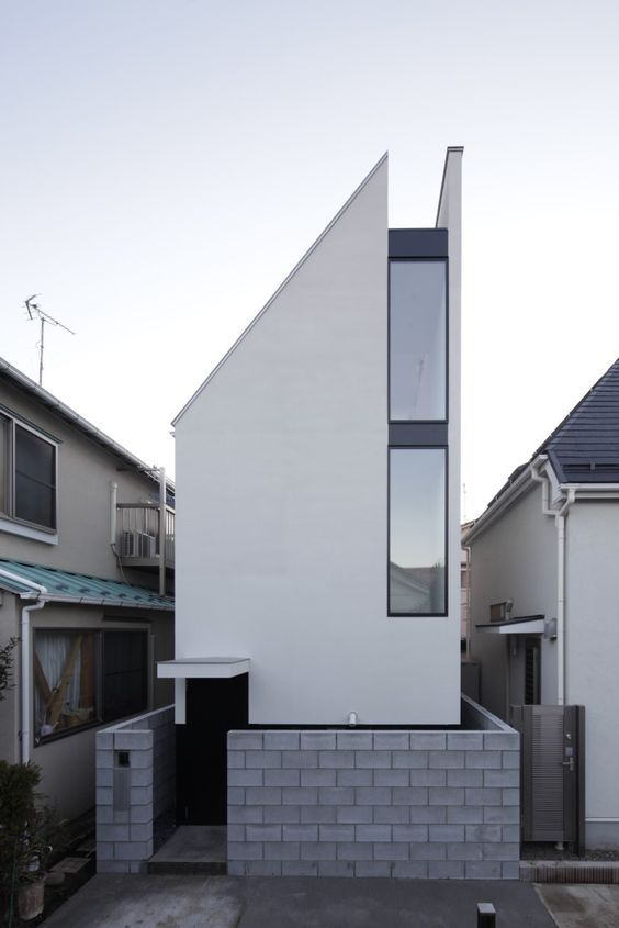 Designed By PANDA Architects, The ST House Is A Small Three Story House  Built On A Site Thatu0027s Just 40 Square Meters Square Feet).