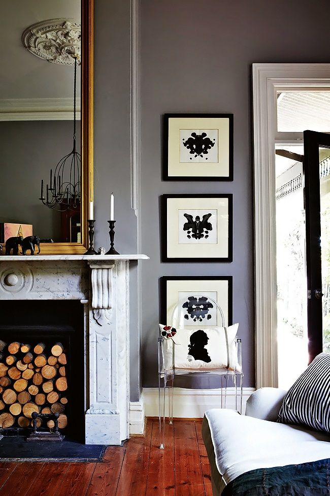 High ceiling - molding - marble fireplace + Ghost chair - ink blot prints