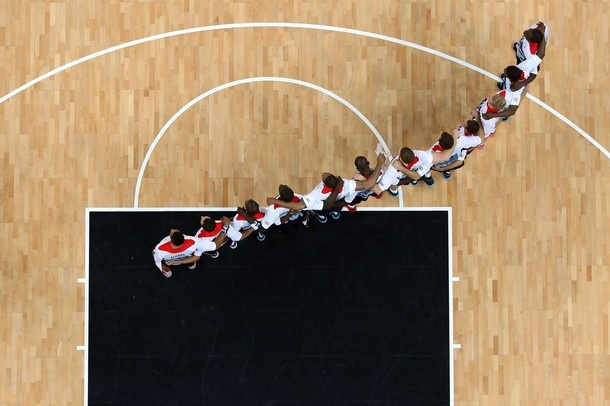 LONDON, ENGLAND - JULY 29:  Team Great Britain huddle on the court prior to their Men's Basketball Game against Russia on Day 2 of the London 2012 Olympic Games at the Basketball Arena on July 29, 2012 in London, England.