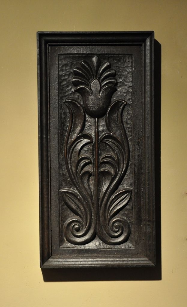An early th century carved oak tulip panel circa