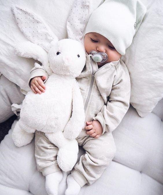 baby boy + rabbit stuffed animal