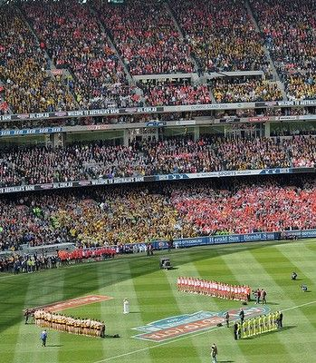 The two teams line up for the national anthem. 2012 AFL Grand Final