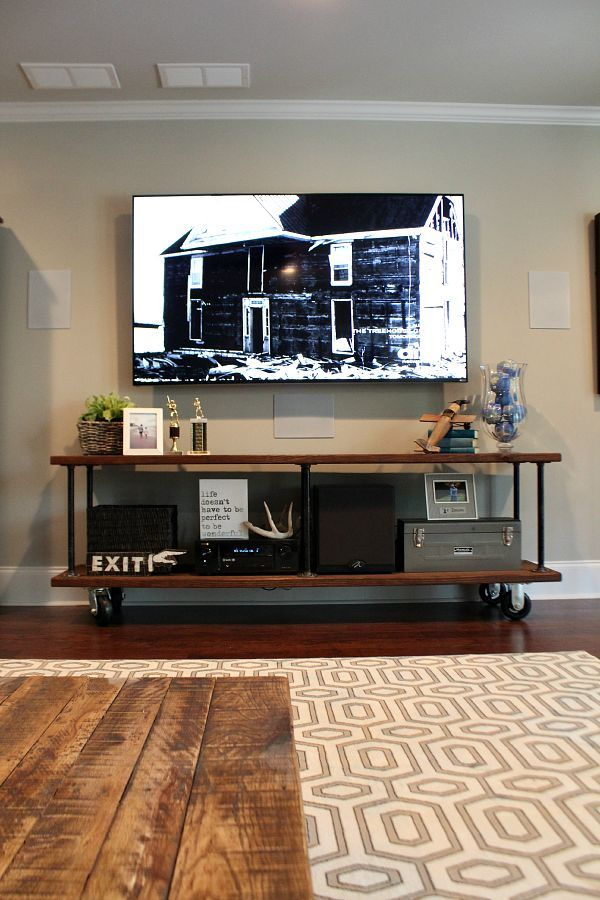 Love the wheels under big furniture (add under daybed?)Industrial tv console easy DIY instructions at refreshrestyle.com