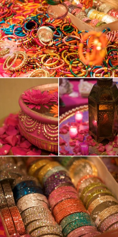 The entire space was transformed with layers and layers of fabric draped in every color imaginable to create a grand entry way as if you were really entering into a bazaar in India.  Authentic looking carts filled with glittering bangles, jewels, and bindis were actually gifts that guests could take away.  #wedding #jewelry