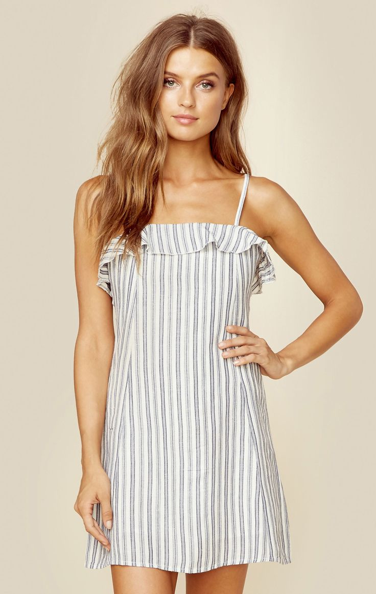 We love this flirty and fun mini dress by Privacy Please! Featuring a subtle stripe print throughout, ruffle detailing on the neckline, and a relaxed mini fit.   Made in USADry Clean Only100% RayonFit