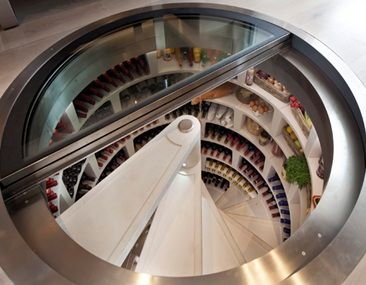 Spiral cellar in white.  I wondered what we could do with the 4ft void under our ground floor!