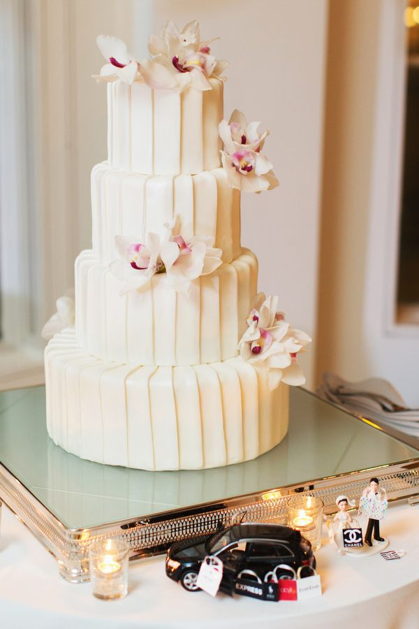 A simply textured wedding cake with floral accents {Photo by Jonathan Young Weddings via Project Wedding}