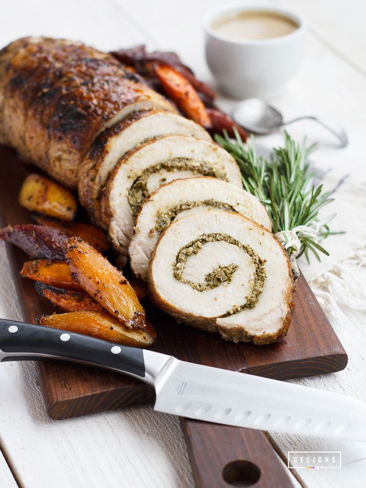 Rosemary Pesto Stuffed Pork Loin with Blood Orange Carrots. This mouthwatering pork loin is stuffed with fresh rosemary pesto and served alongside roasted blood orange carrots. Perfect for the Easter holiday or a springtime dinner. Recipe at www.designsofanykind.com