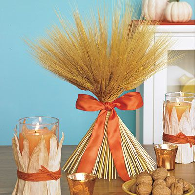 A simple candle craft and a little orange (color of choice) ribbon are all you need to bring in the seasonal feel!    Crafts Needed: Corn husk, Candles and Wheat twist!
