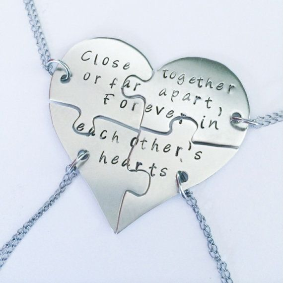 Hand stamped friendship puzzle necklaces shaped by InspiredByBronx