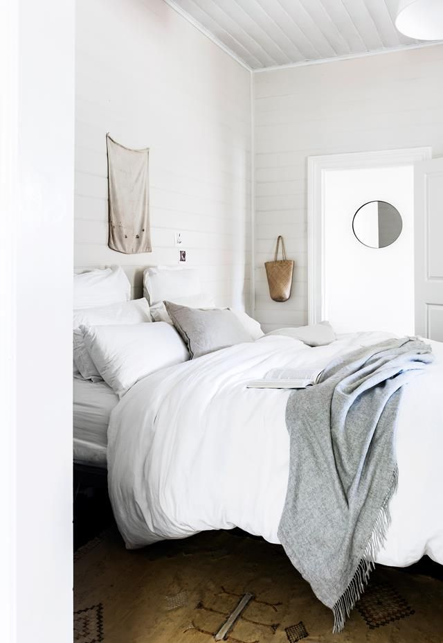 The bedroom in a Byron Bay home adopts a clean, minimalist style but oozes personality with hemp wall hangings. Photography: Maree Homer   Styling: Sarah Ellison   Story: realliving