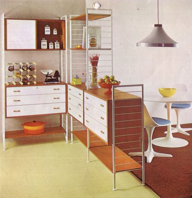 Ladderax white metal and wooden ladders with white fronted cabinets. From the Staples Ladderax catalogue.