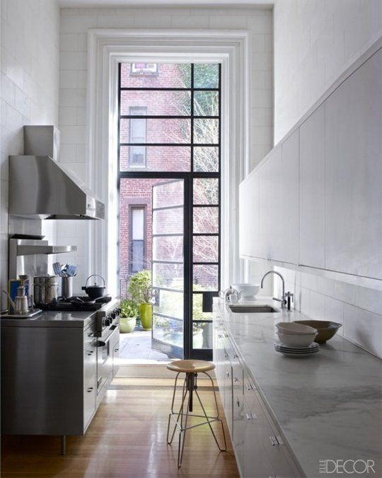 I love long skinny kitchens with a door to a garden or balcony - The New Kitchen: 5 Top Trends