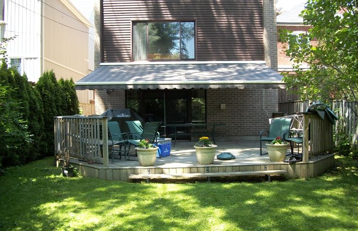 Large Rolltec awning installed over siding #Rolltec #DeckandPatio #awnings #landscaping