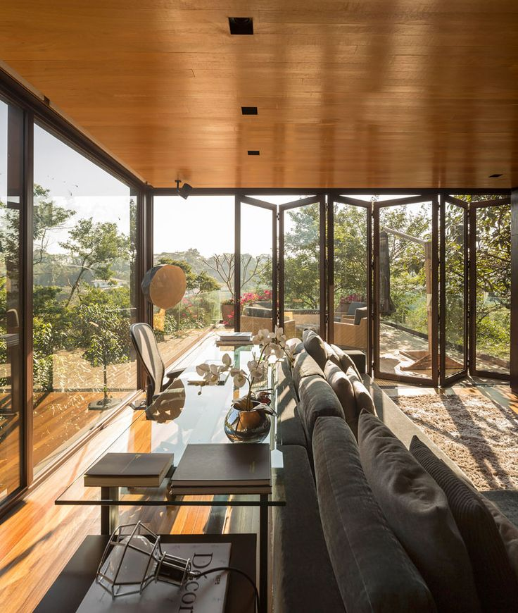 This folding glass wall can be opened to expand the living and games area of this home.
