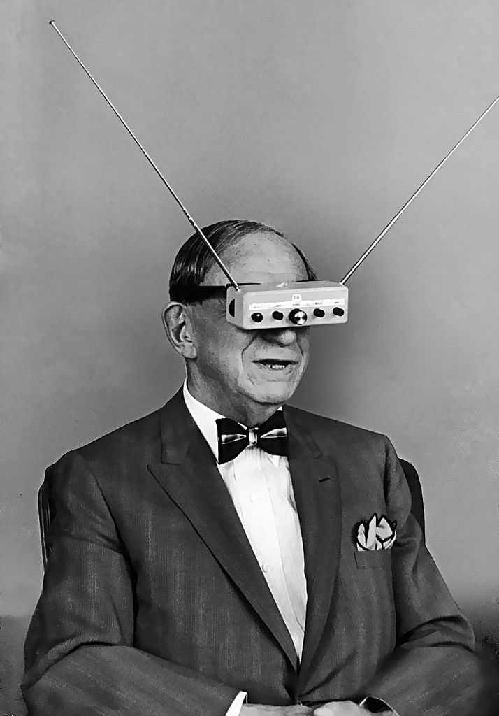 Television eyeglasses, 1963 -  Hugo Gernsback, noted inventor, author, publisher, futurist and the creator of the modern science fiction genre wears a TV visor mock-up to illustrate something he thought would be invented in the coming years. Looks bonkers but he was right -  you can buy video goggles today.
