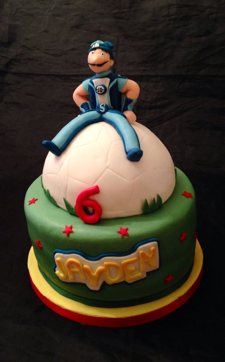 Lazy Town cake with Sporticus sitting on a football
