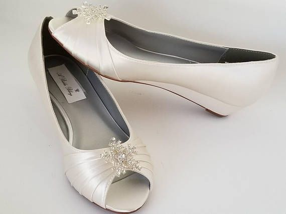 Dyeable wedding shoes with sparkling crystal snowflake are a must have for your winter wedding day. Not only are they stylish but comfortable as well. Perfect to dance the night away! The wedge is approximately 1 inch. The listing picture is in ivory but is available in white as well as