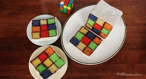 (DONE) I had a Rubik's Cube cake like this made for Tom's surprise graduation/birthday party - it was a hit!  I had it made with chocolate cake and peanut butter icing! The Rubik's Cube squares were made with colored fondant on the outside :)