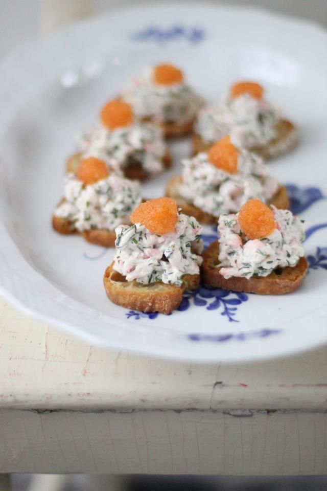 Små Skagen Toast av Leila Lindholm.  Small Skagen toasts.  Skagen is an area in Sweden so the toasts are named after it.  It is usually chopped shrimps with mayonnaise and caviar, perhaps some dill.