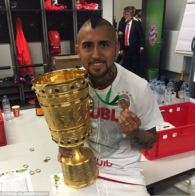 Bayern midfielder Arturo Vidal celebrates after winning the German Cup for the first time in his career