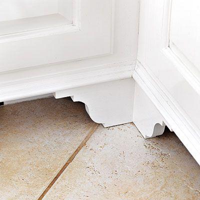Add furniture feet to kitchen cabinets