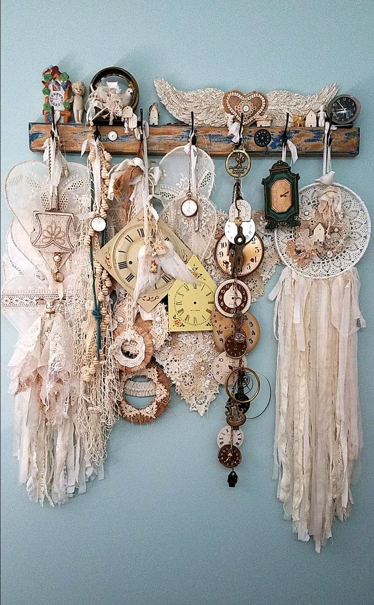 Angel wings, wire hearts, doily dream catchers, and vintage clocks