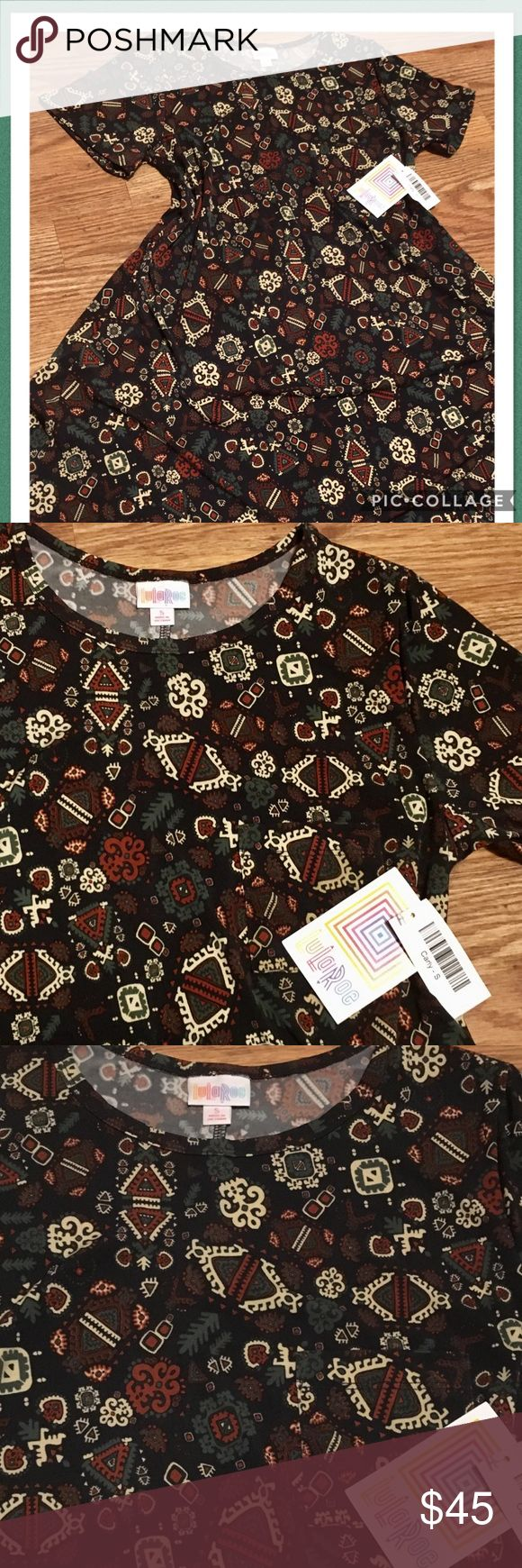 💚LulaRoe Carly Swing Dress ~ Size Small💚 🖤LulaRoe Carly Swing Dress ~ Size Small ~ This Carly is cute and comfy with a black base and pretty pattern of fab fall colors in cream, rusty red, and green ~ Features short sleeves, a crew neckline, asymmetrical hem, and signature patch pocket!🖤 *Cross posted to another site LuLaRoe Dresses Asymmetrical
