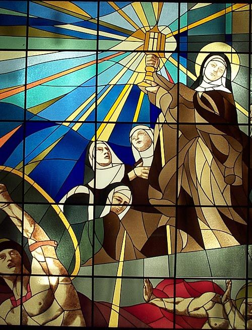"""Eucharistic Miracle of St. Clare """"By imperial order, regiments of Saracen soldiers and bowmen were stationed there (the convent of San Damiano in Assisi, Italy), massed like bees, ready to devastate the encampments and seize the cities. Once, during an enemy attack against Assisi, city"""