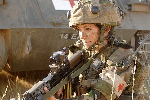 Woman Warrior... GOD BLESS OUR TROOPS! When I was in Basic Training, firing an M80... LOL... (it was HUGE!)... sent ME flying!