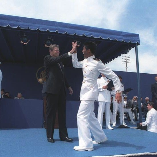 President Reagan congratulating a Midshipman at the Naval Academy Commencement ceremony in Annapolis Maryland.
