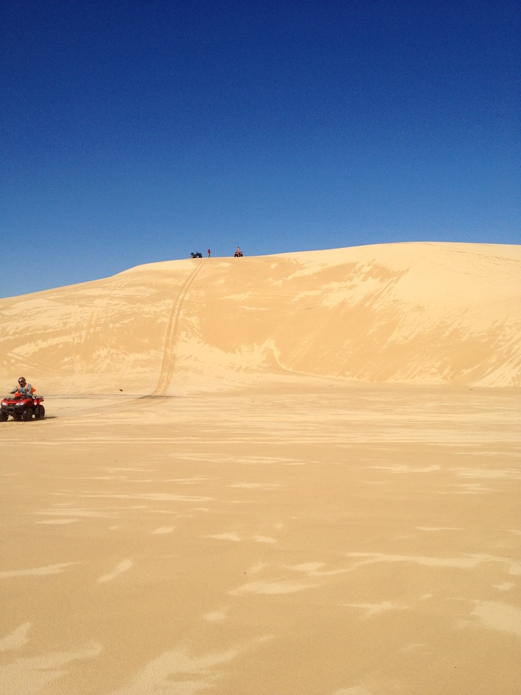 Quad biking down 40-100 foot sand dunes!