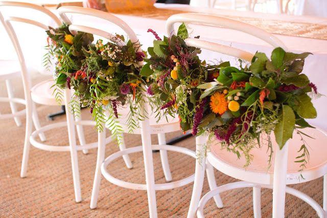 { Naomi Rose Floral Design } Boho wedding | Sheehan Studios Photography | Wedding | Tipi wedding | Mr & Mrs Chairs | Chair flowers | Bright blooms |